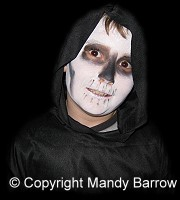 image: boy dressed up as ghoul